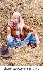 Cute girl on hay field