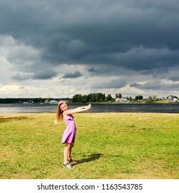 Cute girl on Neva river shore
