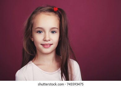 Cute girl on a red background