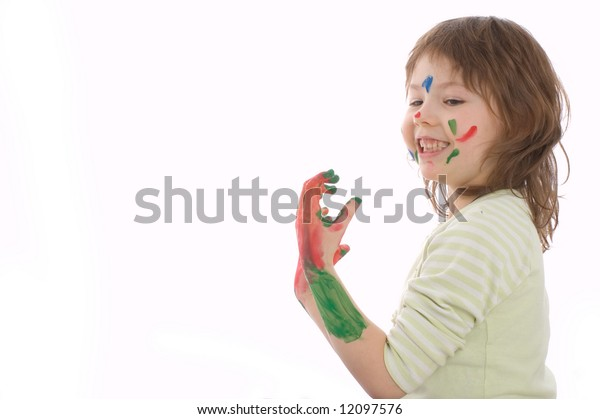 cute girl with painted hands and face, isolated on white