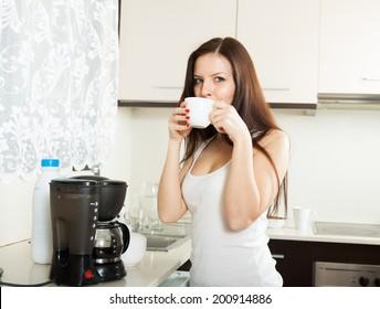cute girl in pajama drinking coffee.