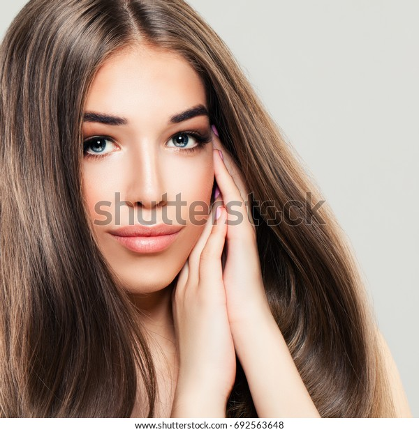 Cute Girl with Perfect Skin and Long Healthy Hair. Beautiful Woman, Skin and Hair Care Concept