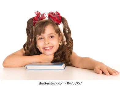 cute girl in pink dress with a book