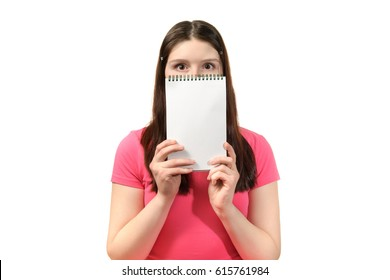 cute girl in pink dress shows surprise notepad