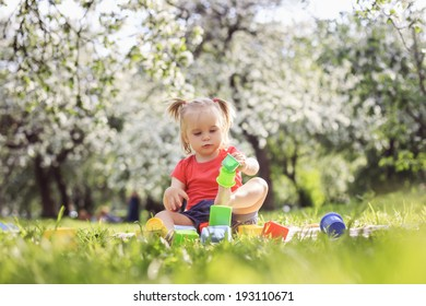 Cute girl plaing in the park on a summer day