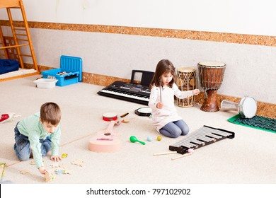 Cute girl playing on the xylophone