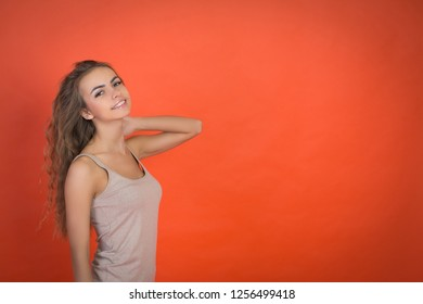 cute girl portrait on red background with copyspace