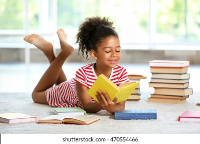 Cute girl reading book at home