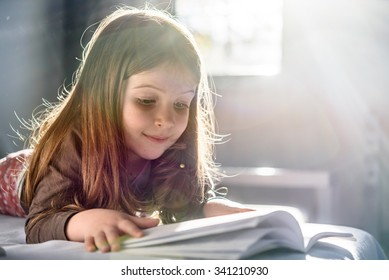 Cute Girl Reading at Home