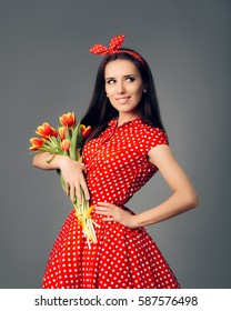 Cute Girl in Retro Red Polka Dress with Tulips - Vintage style spring woman holding flower bouquet