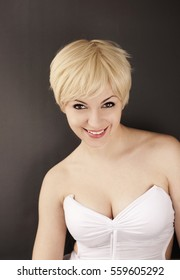 Cute girl with short blond hair smiling