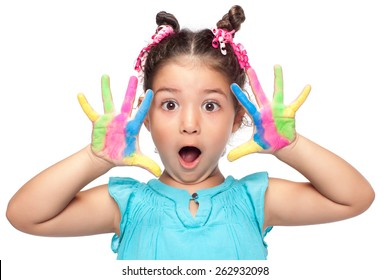 Cute girl showing her colorful hands surprised