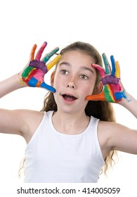 Cute girl showing her colorful hands surprised isolated over white