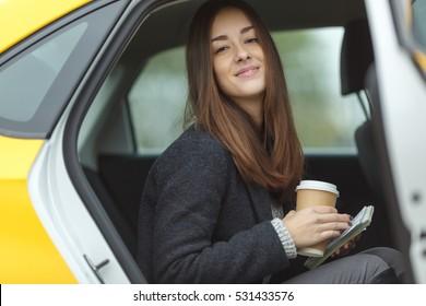 Cute girl sitting in taxi