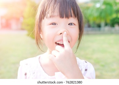 cute girl smile happily in the park
