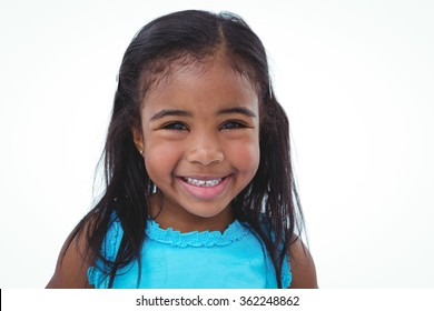 Cute girl smiling at the camera on white screen