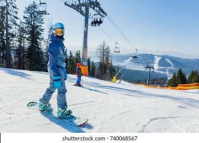 Cute girl with a snowboard on the ski resort