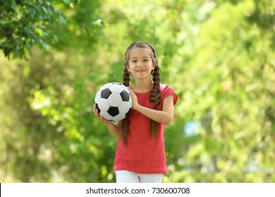 Cute girl with soccer ball in park