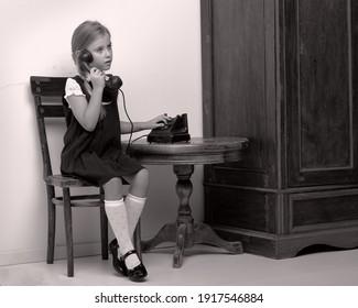 Cute girl speaking via vintage phon