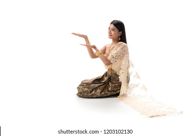 Cute girl in Thai national dress. Looks attractive and so elegant. Thai dress made from greatest Thai silk. Accessories made from gems stone, pearls and Gold. Her eyes looks charm like a spell.