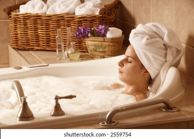 cute girl with a towel on her head in a bath