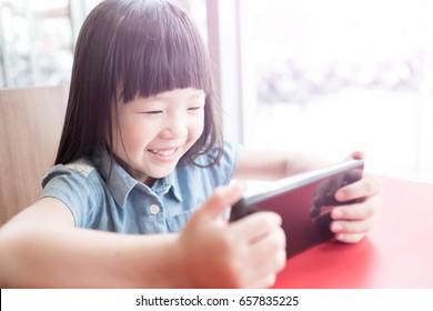 cute girl use phone in the resturant
