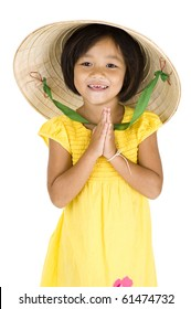 cute girl with vietnamese hat and typical asian welcome expression, isolated on white background