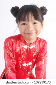 Cute girl wearing red Chinese suit