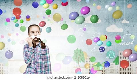 Cute girl wearing shirt and paper mustache