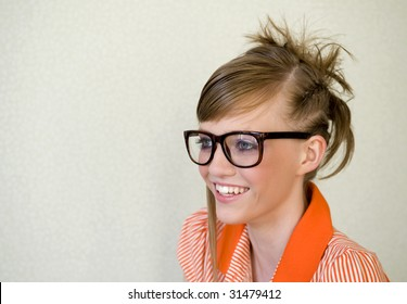 Cute girl wears designer glasses on light background