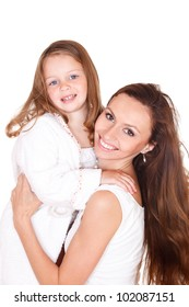 Cute girl in a white bathrobe and her mother