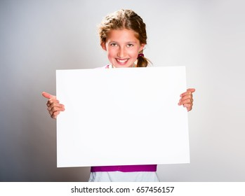 Cute girl with white sheet of paper Isolated on light background