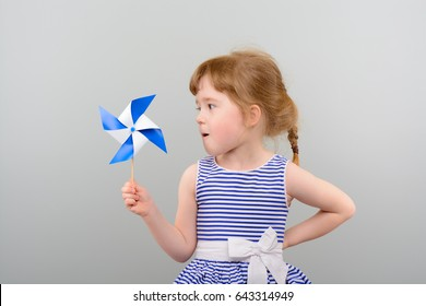 Cute girl with windmill toy