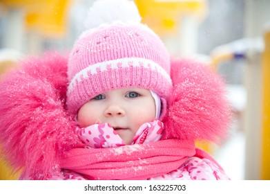 Cute girl winter portrait. Snow.