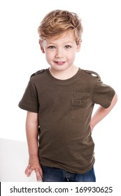 Cute gorgeous boy standing on studio white background.