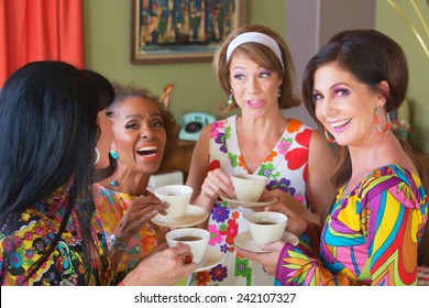 Cute group of retro style women drinking tea