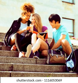 cute group teenages at the building of university