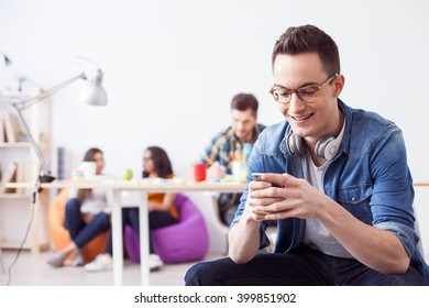 Cute guy is using telephone for fun