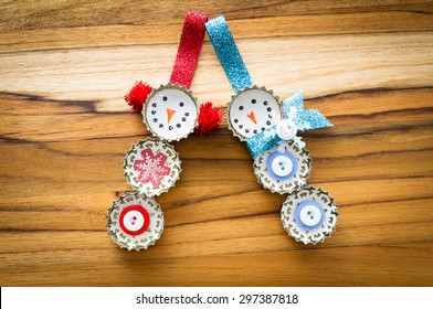 cute hand made recycled christmas ornaments on a wooden table