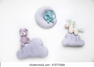 Cute handmade baby toys with pillows isolated on white