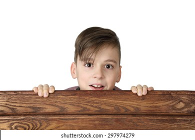 Cute handsome boy look over wooden fence isolated on white background