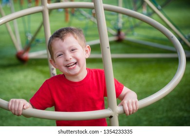 Cute happy and active boy playing on playground