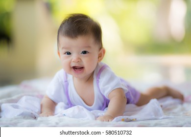 Cute happy asian baby with smile