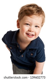 Cute happy boy smiling and leaning forward in studio against white background.