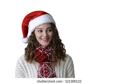 Cute happy Caucasian teenage young woman with Santa hat showing New Year number decoration. Isolated on white background.