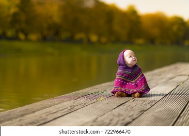 cute happy child baby playing outside in autumn fall sun