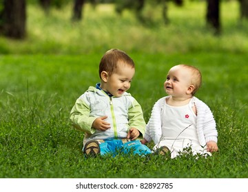 Cute happy children playing in park
