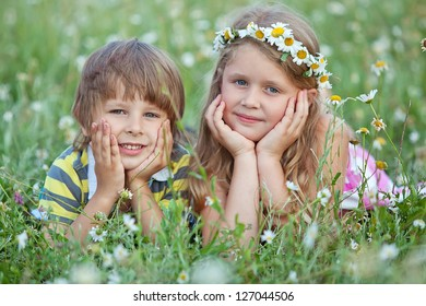Cute happy children playing in spring nature