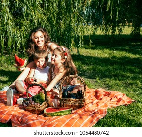 cute happy family on picnic laying on green grass mother and kid