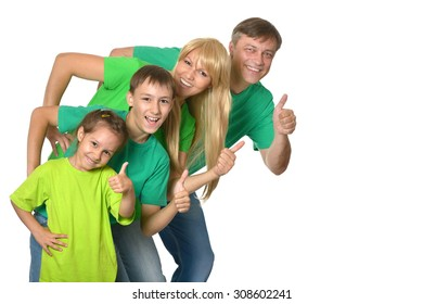 Cute happy family with thumbs up on white